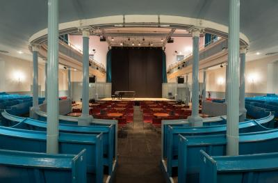 The Queen's Hall auditorium from stalls to stage with cabaret tables